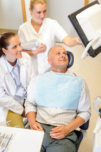 Portrait of mature man consultation with dentist surgeon stomatology clinic