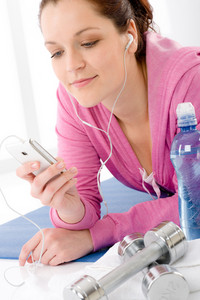 Fitness woman listen music mp3 relax gym on white background