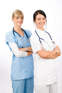Medical team doctor young nurse female smiling look at camera