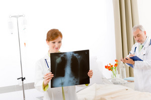Medical team - portrait of two doctor with x-ray in hospital