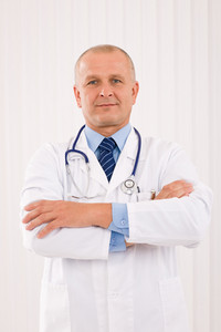 Portrait of mature professional doctor male with stethoscope crossed arms