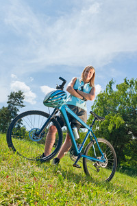 Sport mountain biking happy girl relax in meadows sunny countryside
