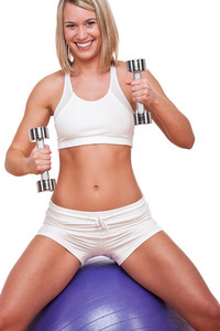 Smiling blond woman with weights on white background