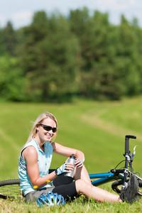 Sport mountain biking happy girl relax in meadows sunny countryside