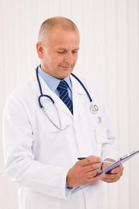 Professional senior doctor male with stethoscope portrait write document folders
