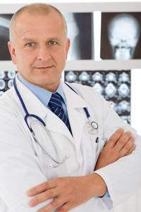 Portrait of male doctor standing at front of  set x-ray