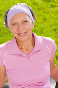 Senior sportive woman smiling outside portrait sunny day