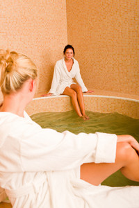 Relax bath healthy spa two beauty woman sitting bathrobe pool