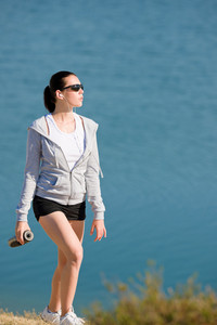 Summer beach active woman walk on beach in fitness outfit