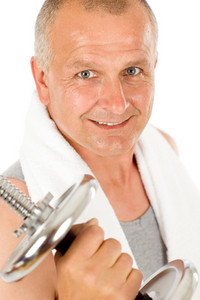 Portrait of happy fit mature man working out with dumbbells