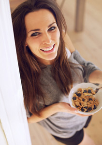 Charming Woman with a Healthy Bowl of Cereal