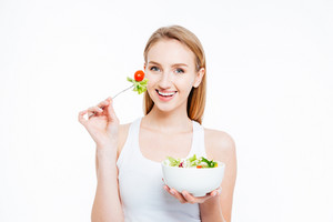 Charming young woman eating healthy food