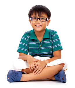Cheeky Boy Cross Legged Sitting On The Floor