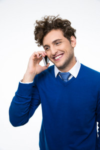 Cheerful business man talking on the phone over gray background