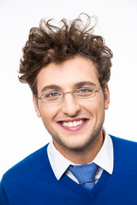 Cheerful business man with curly hair and glasses over white background