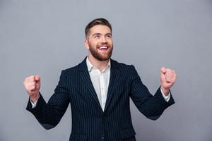 Cheerful businessman celebrating his success