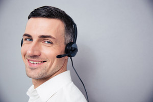 Cheerful businessman in headphones