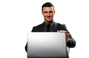 Cheerful businessman using laptop isolated on a white background