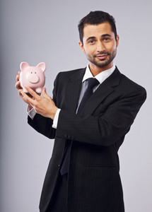 Cheerful Executive Showing You A Piggy Bank