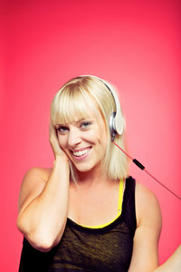 Cheerful female having fun while listening to some funky music