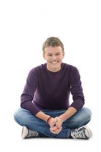 Cheerful happy boy sitting on white background