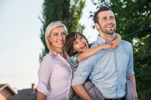 Cheerful parents with happy son posing