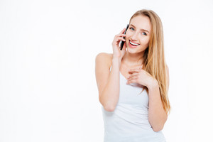 Cheerful woman talking on the phone isolated on a white background