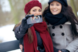 Cheerful Women Enjoying Taking Pictures Outdoors