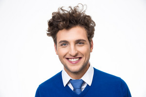 Cheerful young man over gray background