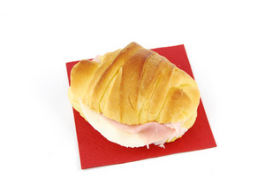 Cheese And Ham Croissant On A Red Napkin