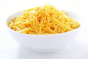 Grated Cheese In White Bowl