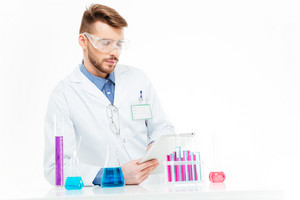 Chemist using tablet computer in laboratory