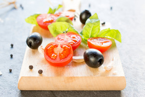Cherry Tomatoes And Black Olives