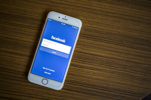 CHIANG MAI, THAILAND - JANUARY 02, 2015: Facebook Login page application using Apple iPhone 6. Facebook is largest and most popular social networking site in the world.
