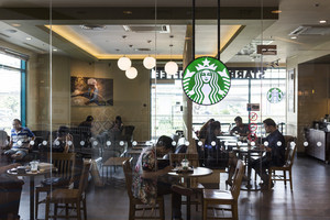 CHIANG MAI, THAILAND - OCTOBER 02, 2014: Starbucks coffee cafe at Chiang Mai Central Airport department store branch.