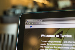 CHIANG MAI, THAILAND - OCTOBER 02, 2014: Twitter application sign in page Apple macbook pro. Twitter is largest and most popular social networking site in the world.
