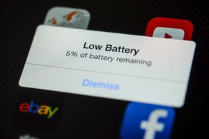 CHIANG MAI, THAILAND - OCTOBER 03, 2014: Low battery show reminder close up on Apple iPad Air device.
