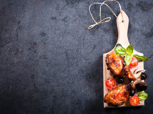 Chicken Drumsticks On Wooden Board