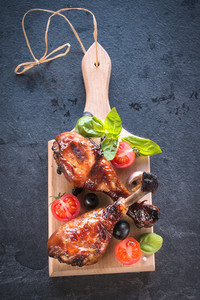 Chicken Legs On Wooden Board