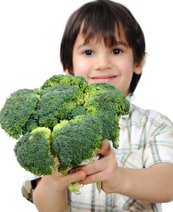 Child and fresh vegetables
