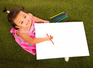 Child Drawing With Multicolored Pencils