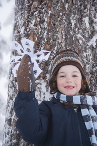 Child holding snowflake