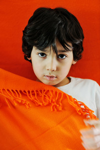 Child portrait with orange blanket