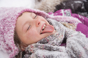 Child tasting snow