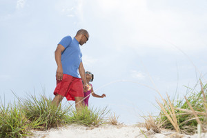 Child with parent at the beach