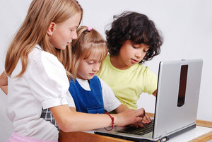 Children activities on laptop put on desk