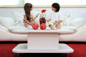 Children at new home with modern furniture