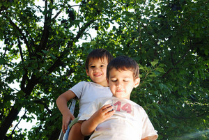 Children taking off the plum in vintage