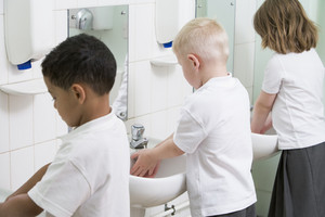 Children washing their hands in a primary school bathroom