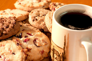 Chocolate And Strawberry Cookies With A Cup Of Coffee